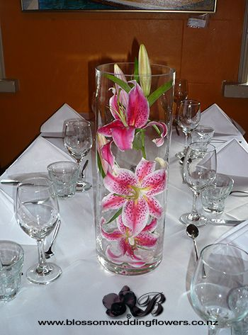 pink lily centerpieces | pink oriental lily vase table arrangements using pink stargazer lilies ...