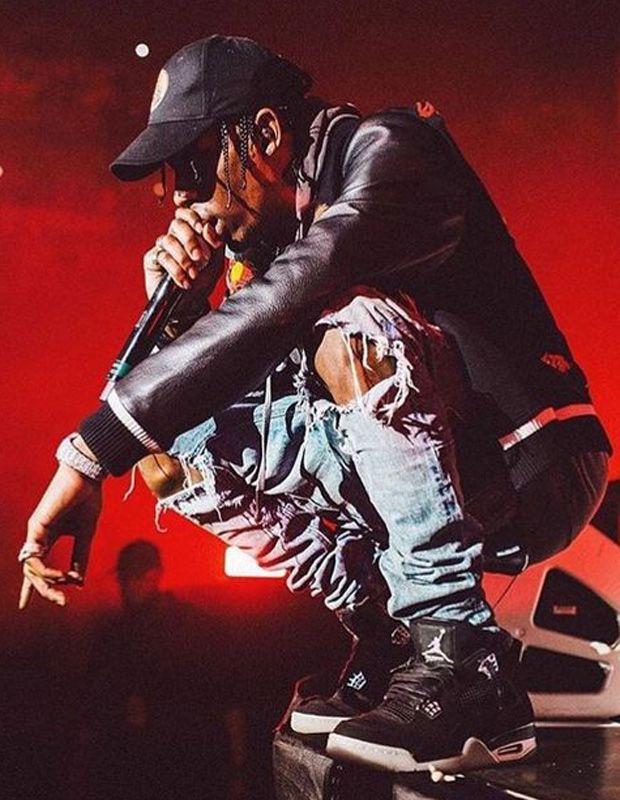Travis Scott in the Eminem x Carhartt x Air Jordan 4