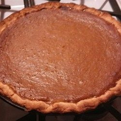Chunks of pumpkin are boiled on the stove and then mashed with evaporated milk, sugar, eggs, and spices to create the filling for a shortening based crust in this delectably rustic Thanksgiving classic.