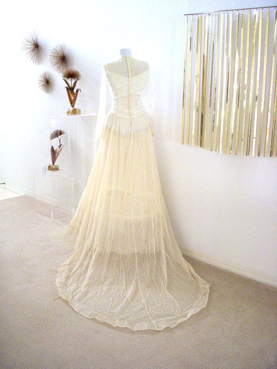 Vintage 40s Ivory Wedding Gown Tulle Satin Lace WWII Ivory Wedding Dress w Train, Hoop Crinoline and Matching 1940s Dog Dress Size Small  by OmAgainVintage  https://www.etsy.com/listing/174387636/vintage-40s-ivory-wedding-gown-tulle?ref=shop_home_active