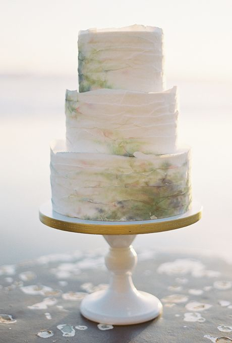 The abstract, ethereal watercolor stains of this confection, created by kneadtomake, were inspired by the bride's watercolor-printed J.Crew heels. The dreamy hues were dry-brushed onto the fondant-covered tiers using powdered food coloring. $10 per slice, kneadtomake Photo: Brett Heidebrecht