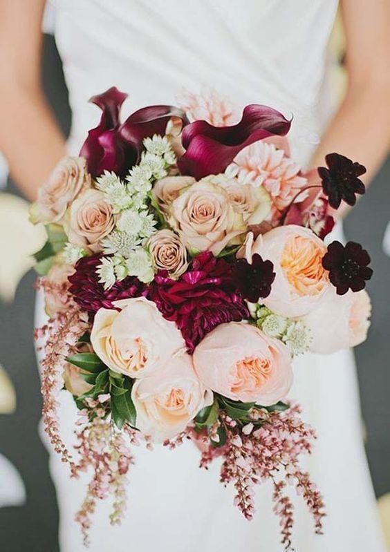 November Wedding Bouquet Bridal Bouquets Fall Flowers Arrangements, calla, roses, peach. 30 Burgundy and Blush Fall Wedding Ideas. Burgundy and blush is one of my favorite color palettes for fall and winter weddings.Burgundy or marsala color is great to highlight that it's a cold season, blush adds delicacy and sweetness to the décor. Choose beautiful blush blooms and add dots of marsala flowers here and there. Gold and white may be also added to the scheme as they'll look great together.