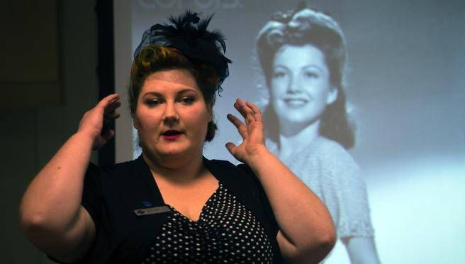 Lena Hardiman, education co-ordinator for Pier 21, takes part in a workshop on how to create victory rolls. (All photos by TED PRITCHARD / Staff)