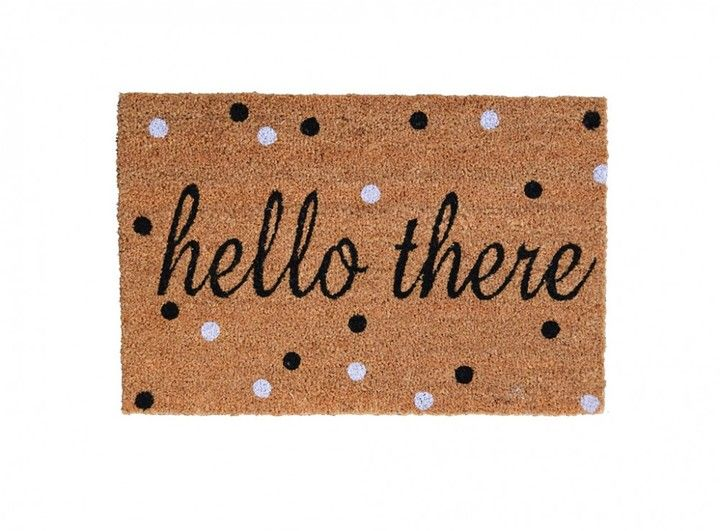 Polka dots make for a playful greeting with this Hello There Doormat.