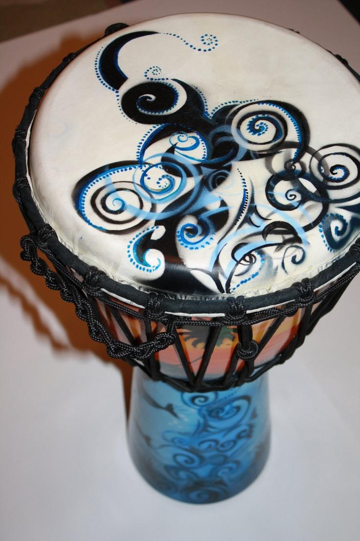 Custom air brushed djembe drum head.