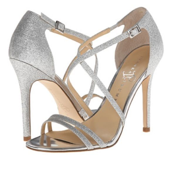Glitter silver strap heels Great for prom or a formal occasion. These glitter strappy heels have only been worn once and are in great condition Ivanka Trump Shoes Heels