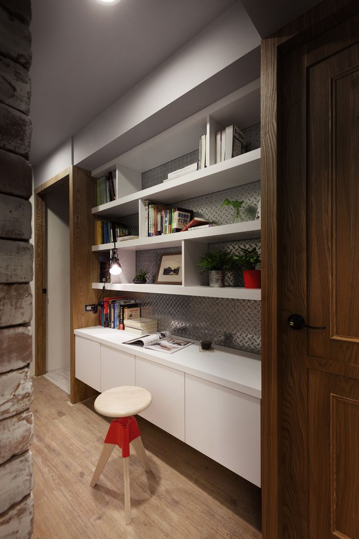 white built in bookcase with wood framed doorway o metal and floating credenza