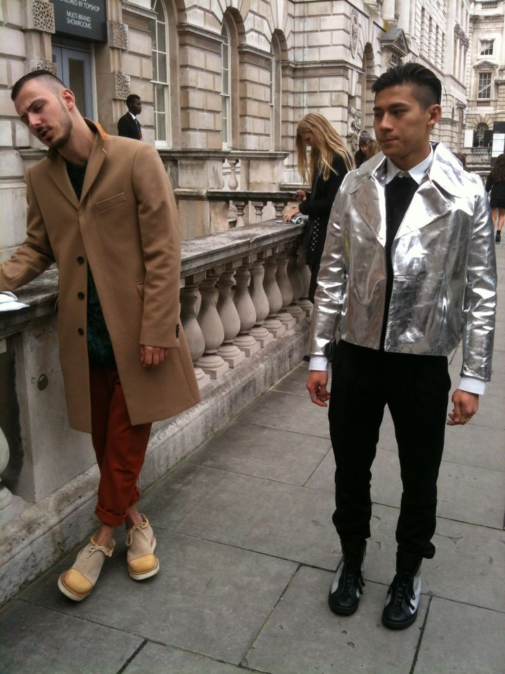 Two contrasting styles collaborating together to produce an outcome that causes passers-by to both double take and reevaluate their own wardrobe. Eccentricity in its finest form with the sheer silver mirror-effect jacket, accompanied by a jet black fur jumper underneath to provide warmth to what could only appear as a chilled image. On the left stands a far less eccentric style - yet still eyecatching none the less - made complete with a camel trench coat draped over broad shoulders. Sophie…