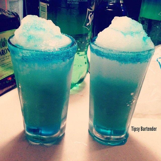 ELSA FROM FROZEN COCKTAIL Bottom Layer- 1 oz. (30ml) Coconut Rum 1 oz. (30ml) Amaretto  1/2 oz. (15ml) Blue Curacao Ice Blend  Top Layer 1 oz. (30ml) Coconut Rum 2 oz. (60ml) Lemon Lime Soda Splash Blue Curacao