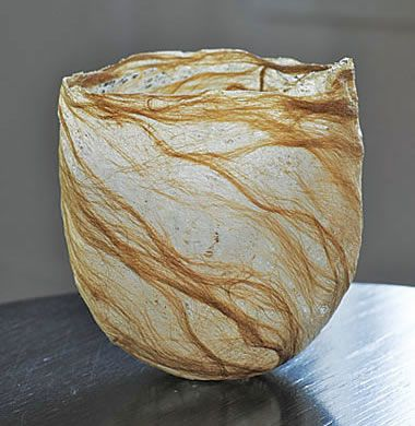 kay sekimachi. vase sculpture made from fibres.  looks like felting but very very thin and lace like. lovely accompaniment of light through thinner sections of form. sense of growth and flow. colour emphasises softness