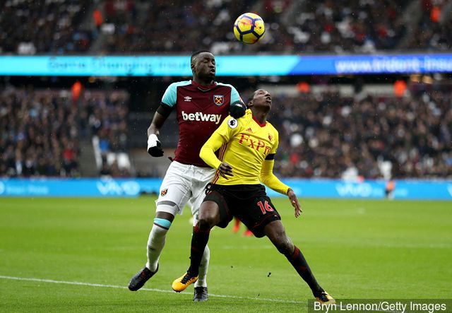 Abdoulaye Doucoure of Watford is challenged by Cheikhou Kouyate of West Ham United during the Premier League match between West Ham United and Watford at London Stadium on February 10,...