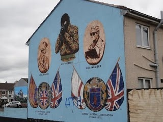 Belfast, Northern Ireland.  One of many military propaganda paintings.  The Union Jack is EVERYWHERE and the currency is the British Pound.  I'm not sure I wouldn't be pissed, too were I Irish...