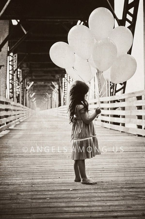 great read.......blog about photography ideas. Cute pose for baptism pics. White balloons, white dress