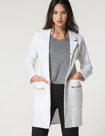 The Signature Lab Coat in White is a contemporary addition to women's medical outfits. ShopJaanuufor scrubs, lab coats and other medical apparel.