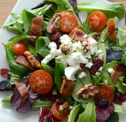 Ingredients:   Salad:   6 cups salad greens, such as spring mix with arugula  2 slices bacon, cooked crisp and crumbled  3 tablespoons t...