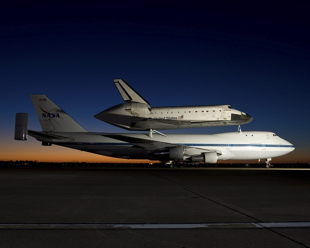Space Shuttle Endeavour and NASA's 747 Shuttle Carrier Aircraft (SCA) at Ellington Field in the late evening hours of September 19, 2012 before it departs for California.