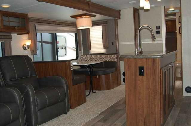 """2016 New Heartland NORTH TRAIL 32RLTS CALIBER EDITION Travel Trailer.Recreational Vehicle, rv, 2016 HEARTLAND NORTH TRAIL 32RLTS CALIBER EDITION, Great layout! This layout is very roomy in the rear with opposing slides and a center island to give you all the room needed for company or comfort. Huge rear window, comfortable reclining chairs, and a full size couch that still makes into a bed makes it a very popluar trailer for the """"Go and stay"""" camper. If your have a favorite site that you…"""