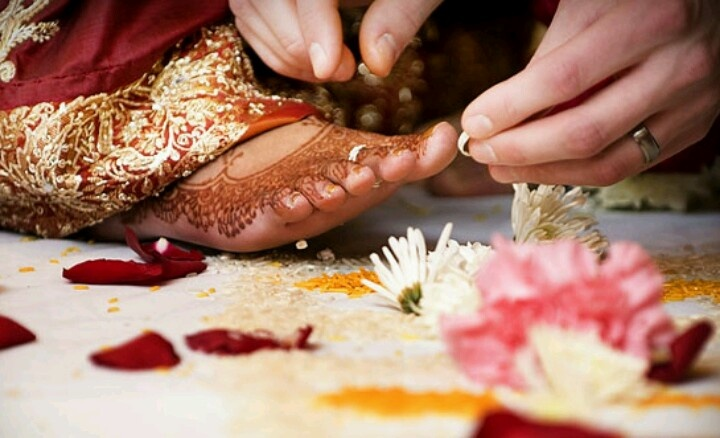 Groom putting toe rings in Indian Bride. I can't wait till ...