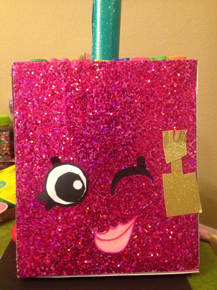 Shopkins Valentine's Day Box - Polly Polish   SUPPLIES: Shoe box  Glitter scrapbook sheets  Toilet paper roll    1.Glue the sheets to the shoebox 2. Wrap a sheet around the toilet paper roll and glue to the top 3. Card stock for eyes and lips