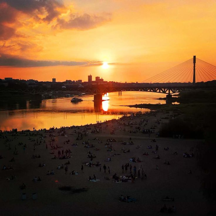 Sunset over Warsaw #warsaw #poland #beach #sunset #bridge #vistula #river #city #people #sun