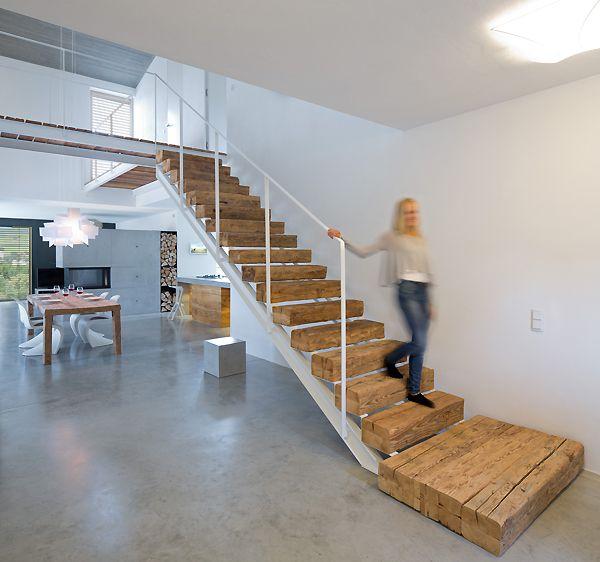Wohnhaus Stallwang Raw wood and white metal stairs