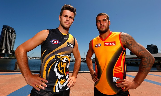 Trent Cotchin (L) and Lance Franklin (R) pose for a photo during an AFL Indigenous All-Stars press conference at AFL House, Melbourne. (Photo: Michael Willson/AFL Media)