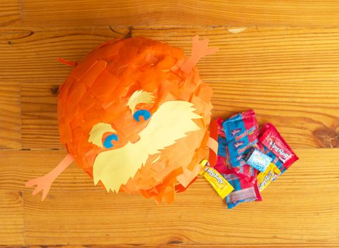 The Lorax Mini-Pinata- Cut eyes, eyebrows and whiskers out of coordinating paper. Attach to pinata and fill with candy!