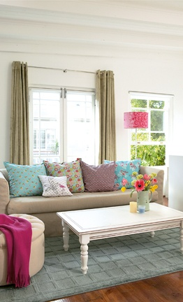 Shabby chic living room -- I love the different throw pillows!