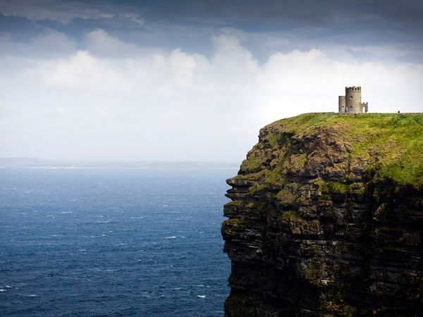 Atop the highest point of the Cliffs of Moher in County Clare, O'Brien's Tower overlooks Galway Bay. Ireland.