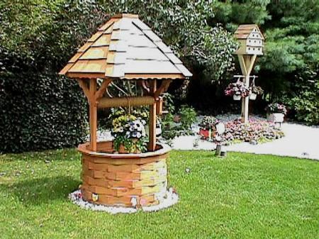 Wishing well--possible idea to cover the well pipe in the
