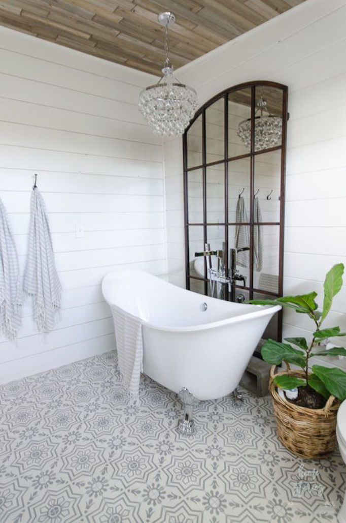 BECKI OWENS- 7 Elements of the Modern Farmhouse. White bathroom with warm rustic wood, shiplap, cement tile, claw foot tub, and industrial mirror.