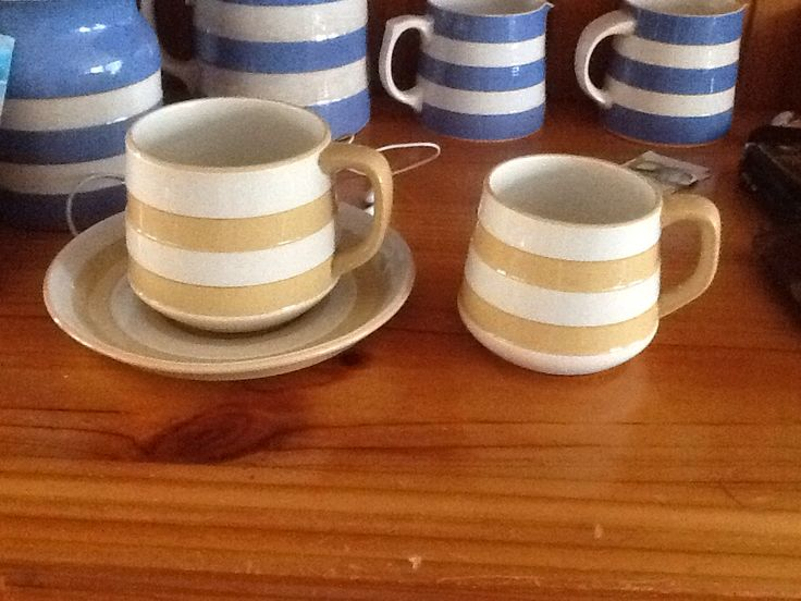Gold Cornishware. Large cup and saucer with small cup