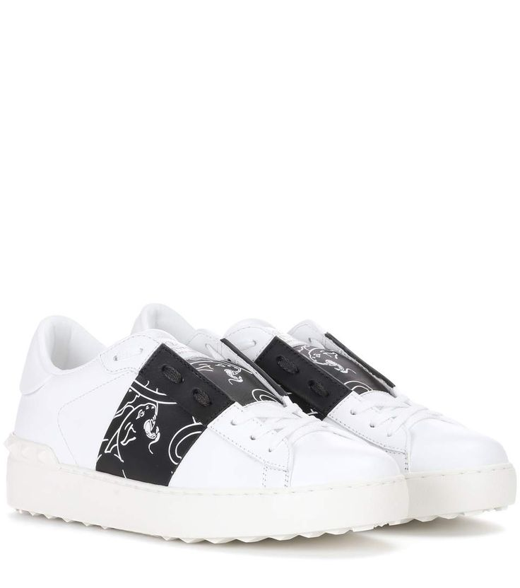 VALENTINO - Valentino Garavani leather sneakers - For the Pre-Fall 2017 collection, Valentino drew inspiration from the panther motif the house used in the '60s. These leather sneakers showcase this retro emblem with compelling power in contrasting black and white. Wear yours with faded denim crops for a look that's laid back and chic. - @ www.mytheresa.com