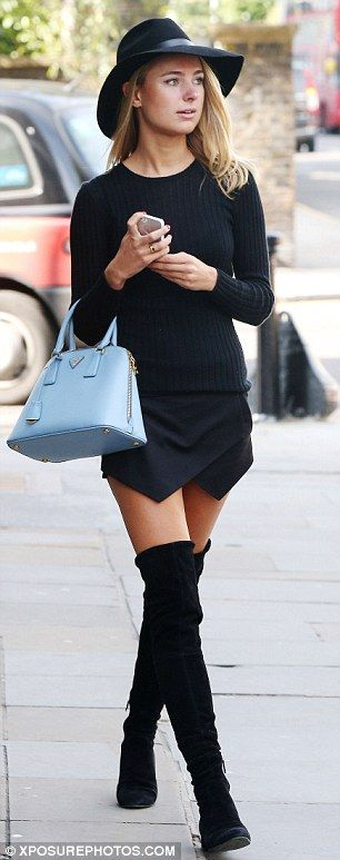 Secret smile: Kimberley Garner, who was on TV series Made In Chelsea smiled as she walked - wow what a multi-tasker!!