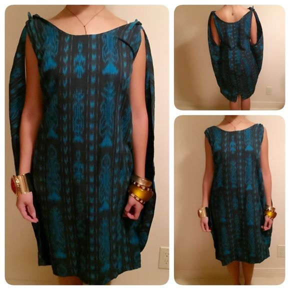 """Lovely Aztec Ethnic Festive Handwoven Midi Dress This is a one of a kind dress! Beautifully handwoven. Side straps can be adjusted and worn different ways! 100% cotton made in Guatemala. Length measures about  38"""" and bust about 38."""" Handmade Dresses Midi"""