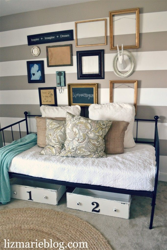 Well, I just love everything here... daybed, gallery wall, Michigan art, stripes. Yes please! From lizmarieblog.com