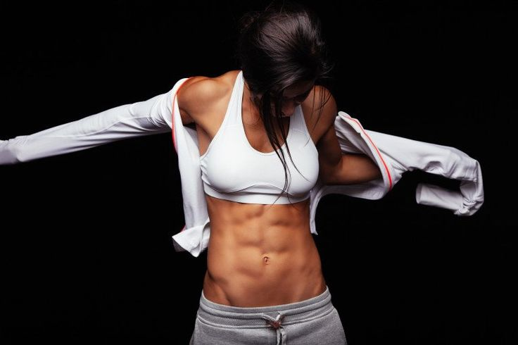 woman wearing sports bra with six pack abs