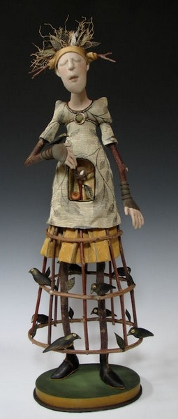 Akira  Larry Blount are a husband  wife artist team. Akira originally needle-sculpted traditional doll forms, however over time, she has progressively used more natural elements in her art. She has always found woodlands to be particularly inspiring  Larry has a passion for working with wood, so together they strive to personify the spirit of nature in their work. Each doll is a combination of cloth  natural materials, treated with special varnish to help retain moisture  flexibility.