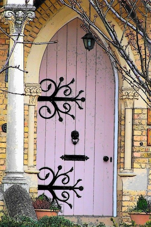 Arched (and pink!) doors are perfection...xx