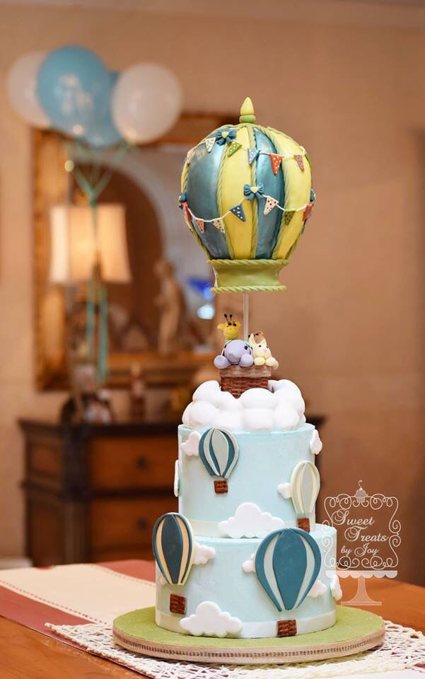 Hot air balloon.  Gravity defying cake.  Baby shower cake