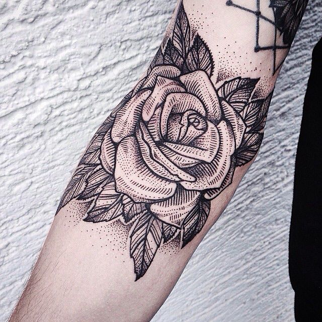 American traditional rose tattoo. Red with pearls around.