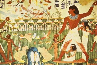 In Egyptian art, the size of the individual was based on status.  As you can see in this photo, the male is the largest in perspective and is more in the foreground.  This would go to show that he is portrayed as a person with importance.  The lady drawn in a smaller size in front of the man is most likely his wife.  The ones drawn in the background who are relatively small in size are most likely slaves.
