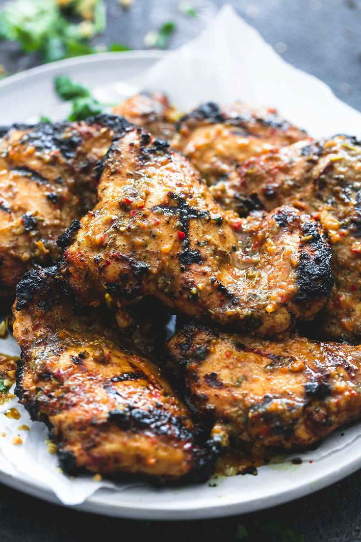 A zesty lime and island-spiced marinade gives this easy grilled jamaican jerk chicken tons of bold flavor and a juicy, tender center.