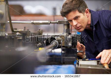 Factory Engineer Operating Hydraulic Tube Bender - stock photo