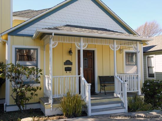 Front porch with a hip roof design evokes an old-west feel with board-and-batten siding, spindles and corner brackets. Front-Porch-Ideas-and-More.com  #frontporch