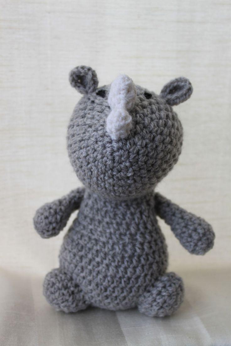 Ron the rhino. Amigurumi plush animal. The animal is approximately 20 cm tall.