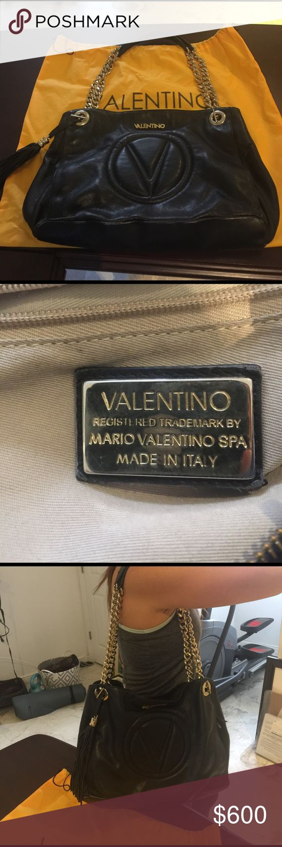 "AUTHENTIC MARIO VALENTINO VERA  BLACK SHOULDER BAG AUTHENTIC MARIO VALENTINO VERA  BLACK SHOULDER BAG TOP HANDLE 10"" TOP MAGNETIC SNAP BUTTON CLOSURE SILVER STONE HARD WARE TWO INTERIOR ZIP POCKETS INCLUDING DUST BAG SOME SCRATCHES IN THE BOTTOM Valentino Bags Shoulder Bags"