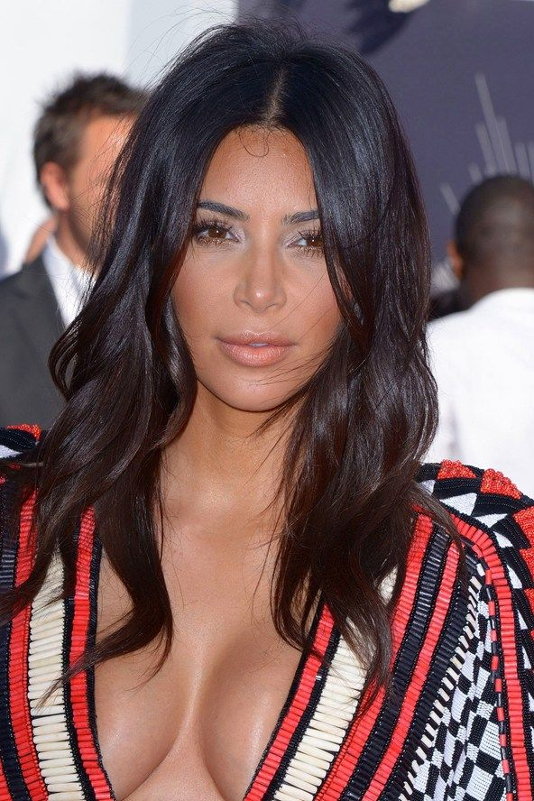 "Kim Kardashian's jaw dropping shoulder-length hair with sleek centre-parted style | To make this hairdo shop our Dark Brown 22"" Remy Clip in Human Hair Extensions 