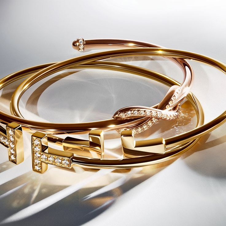 This year, give the gift of Tiffany. Timeless Tiffany T wire bracelets in 18k gold and a Tiffany Infinity cuff in 18k gold with diamonds are gifts she will cherish forever