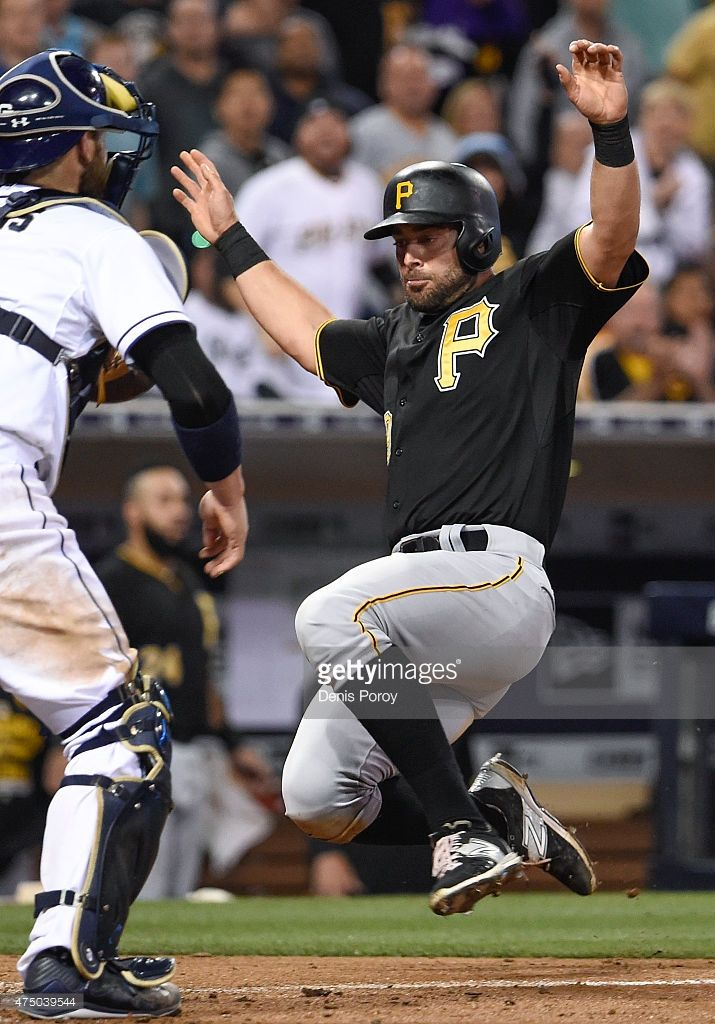 Francisco Cervelli #29 of the Pittsburgh Pirates scores ahead of the throw to Derek Norris #3 of the San Diego Padres during the sixth inning of a baseball game at Petco Park May 28, 2015 in San Diego, California.
